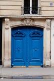 Portes à deux battants bleues Photo stock