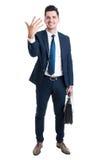 Portföljen och visningen för försäljningsman numrerar den stående hållande fem Arkivbilder