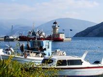 Portfartyg och fyr Arkivbild