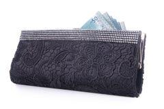 Portfel. kobieta portfel z pieniądze na tle Zdjęcie Stock