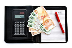 Portfolio. Leather covered calculator memo pad with banknotes and a pen. Isolated on white Stock Images