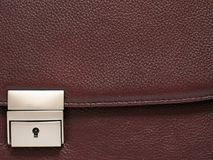 Portfolio fastener. Fastener and part of a leather business portfolio. A portfolio from a natural imprinted skin of brown colour royalty free stock images