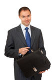 Portfolio investor. Joyful businessman with a briefcase Royalty Free Stock Photography