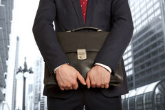 Portfolio investor. Businessman with briefcase Royalty Free Stock Photos
