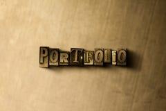 PORTFOLIO - Nahaufnahme des grungy Weinlese gesetzten Wortes auf Metallhintergrund Stockfotos