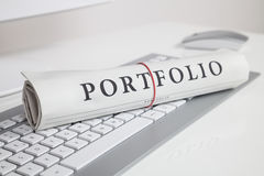 Portfolio written on newspaper. On computer keyboard Stock Photos