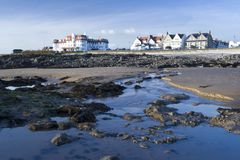 Porthcawl Seafront. Looking back at hotels on Porthcawl seafront from beach at low tide. South Wales, UK Stock Images