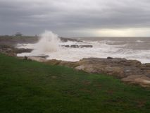 Porthcawl on a stormy day with waves crashing onto rocks, South Wales royalty free stock photography