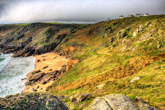 Porthchapel beach Cornwall England UK near the Minack Theatre in HDR Stock Images