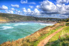 Porthcothan Bay Cornwall England UK Cornish north coast between Newquay and Padstow in colourful HDR Royalty Free Stock Photos