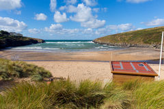 Porthcothan Bay Cornwall England UK Cornish north coast. Between Newquay and Padstow on a sunny blue sky day with hut and white clouds royalty free stock photography