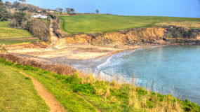Porthcurnick beach Cornwall England UK north of Portscatho in colourful HDR Royalty Free Stock Images