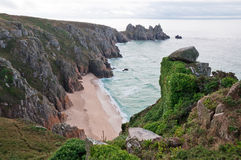 Porthcurno Beach, Cornwall. Porthcurno Beach in cloudy weather, Cornwall, west England Stock Image