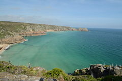 Porthcurno beach. View from Minack theatre Cornwall UK, Turquoise sea waters with stone steps into the beach Stock Images