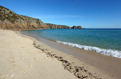 Porthcurno sandy beach shore line, Cornwall UK. Royalty Free Stock Photo