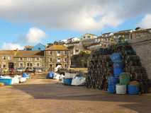 Porthleven Harbour Cornwall. Fishing nets and crab pots line the quayside in the harbour at Porthleven in Cornwall Stock Photography