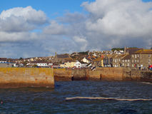 Porthleven Harbour Cornwall. The entrance to the harbour in the Cornish village of Porthleven Stock Photo