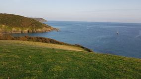 Porthlune cove in the distance . Southwest coastal path . South Cornwall Stock Photography