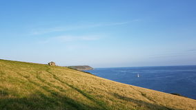 Porthlune cove in the distance . Southwest coastal path . South Cornwall stock image