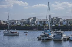 Porthmadog, North Wales - the boats in the bay. This image shows a view of some boats in Porthmadog, North Wales, the UK. It was taken on a bright, sunny day in royalty free stock photos