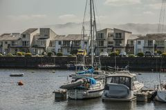 Porthmadog, North Wales, the UK - some boats in the bay. This image shows a view of some boats in Porthmadog, North Wales, the UK. It was taken on a bright stock photography