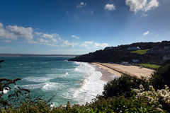 Porthminster beach St Ives Cornwall England with white waves and blue sea and sky Stock Photography