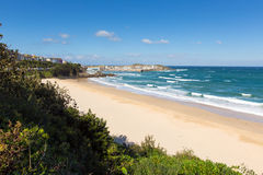 Porthminster beach St Ives Cornwall England with white waves and blue sea and sky Stock Images