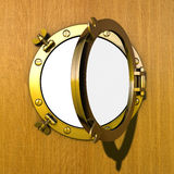 Porthole. Illustration of an opened gilded porthole in a wooden cabin wall Royalty Free Stock Images