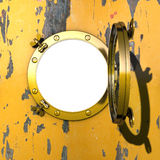 Porthole. Illustration of an open gilded porthole in a cabin wall with peeling yellow colour Stock Image