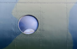 Porthole aboard a military aircraft Royalty Free Stock Photography