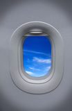 The Porthole of airplane and beautiful sky Stock Photos