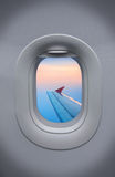 The Porthole of airplane and beautiful sky Stock Image