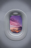 Porthole of airplane with beautiful sky Stock Images