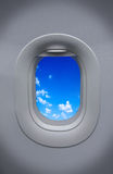 Porthole of airplane with beautiful sky Royalty Free Stock Photo