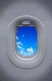 Porthole of airplane with beautiful sky Royalty Free Stock Photo