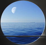 Porthole with blue ocean view Stock Photos