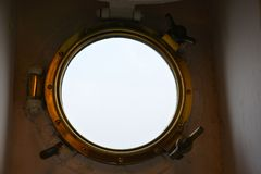 Porthole from the inside on a ship Stock Photo