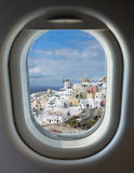 Porthole and island of Santorini Stock Image
