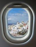 Porthole and island of Santorini Stock Image