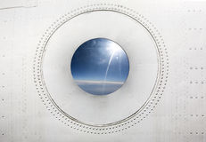 Porthole of an jet airplane Royalty Free Stock Photography