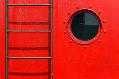 Porthole and ladder Stock Image