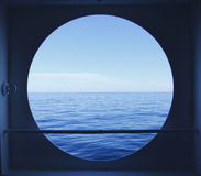 Porthole with ocean view. Porthole with blue ocean view Stock Photography