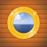 Porthole sea and clouds Royalty Free Stock Photography