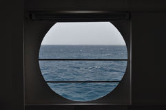 Porthole sea view Royalty Free Stock Photo