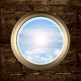Porthole with sky view Stock Photo