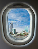 Porthole, top view on the blue sky and clouds Stock Images