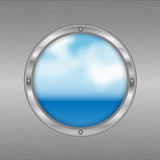 Porthole with a view of the sea Stock Photography