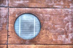 Porthole in the wood Royalty Free Stock Image