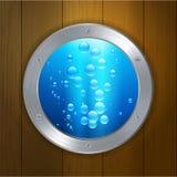 Porthole on wood under the sea Royalty Free Stock Images