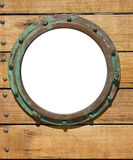 Porthole and wooden wall Stock Photography